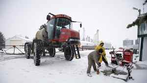 Workers prepare to pressure wash a sprayer at the Wigmore Farms near Regina on Wednesday, Nov. 10, 2010.