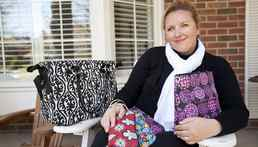 Jacqueline Dinsmore's Toronto-based company, Luvali Convertibles makes convertible bags that can be transformed into different styles by changing or reversing a slip cover or removing a strap. She is seen at her Oakville home on May 9, 2011.
