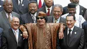 Libyan leader Moammar Gadhafi, centre, leans on the shoulders of Egypt's President Hosni Mubarak, right, and Yemen's President Ali Abdullah Saleh, left, as they laugh during a photocall before the second Afro-Arab Summit in Sirte in this October 10, 2010 file photo.