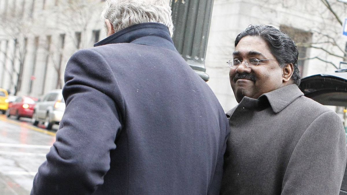 Galleon hedge fund founder Raj Rajaratnam, right, arrives at Manhattan Federal Court for his insider trading case in New York March 23, 2011.