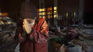 Momoko Onodera prays as she talks about her husband who died in the tsunami at an evacuation center on March 18, 2011 in Kesennuma, Japan.