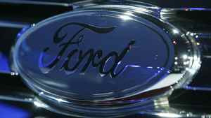 The grill emblem on the Ford Taurus X during its debut at the Chicago Auto Show in 2007.