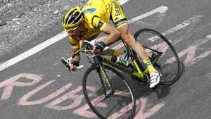 Europcar rider Thomas Voeckler of France wears the leader's yellow jersey as he rides on a mountain during the 12th stage of the Tour de France 2011 cycling race from Cugnaux to Luz-Ardiden July 14, 2011.