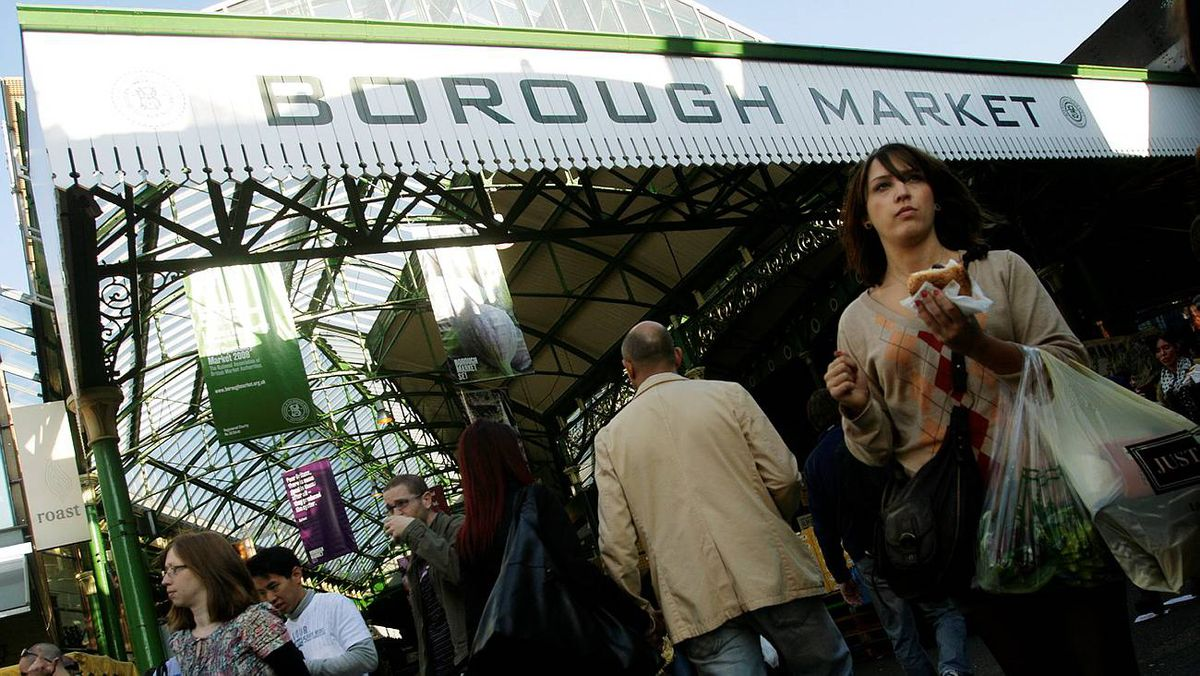 A shopper walks by the eastern entrance of Borough Market in London. British shoppers are being told to choose what to eat based on food security issues as well as environmental and health considerations.