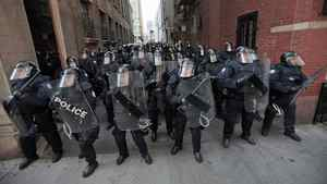 Riot police move through a downtown alley during the G20 summit in Toronto on June 25, 2010.