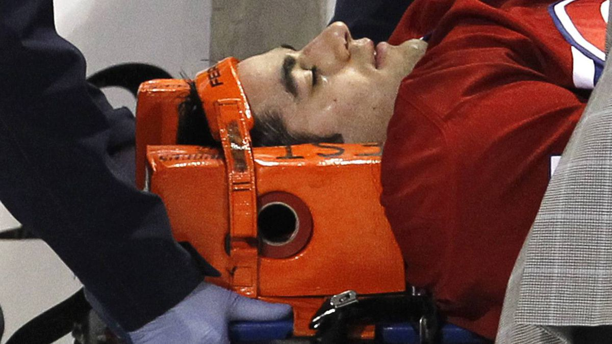 Montreal Canadiens' Max Pacioretty is wheeled away on a stretcher after taking a hit by Boston Bruins' Zdeno Chara during second period NHL hockey action Tuesday, March 8, 2011 in Montreal. Pacioretty has been diagnosed with a severe concussion and a fractured vertebra. THE CANADIAN PRESS/Paul Chiasson