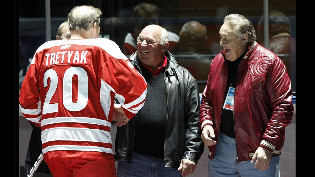 Canadian former hockey players Phil Esposito, right, and Dennis Hull, centre, greet former rival Russian, hockey legend Vladislav Tretiak, during an exhibition game in Moscow on Feb. 25, 2012 between teams of Russian and world stars to mark the anniversary of U.S.S.R.-Canada 1972 Summit Series.