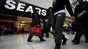 Shoppers outside of Sears Canada at Toronto's Eaton Centre.