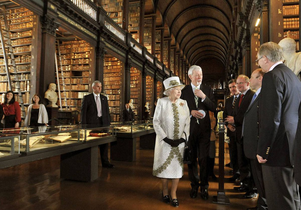 Britain's Queen Elizabeth II is introduced to guests by provost John Hegarty (CR) in the Long Room during a tour at Trinity College in Dublin. It is first visit of a British monarch to the Irish Republic.
