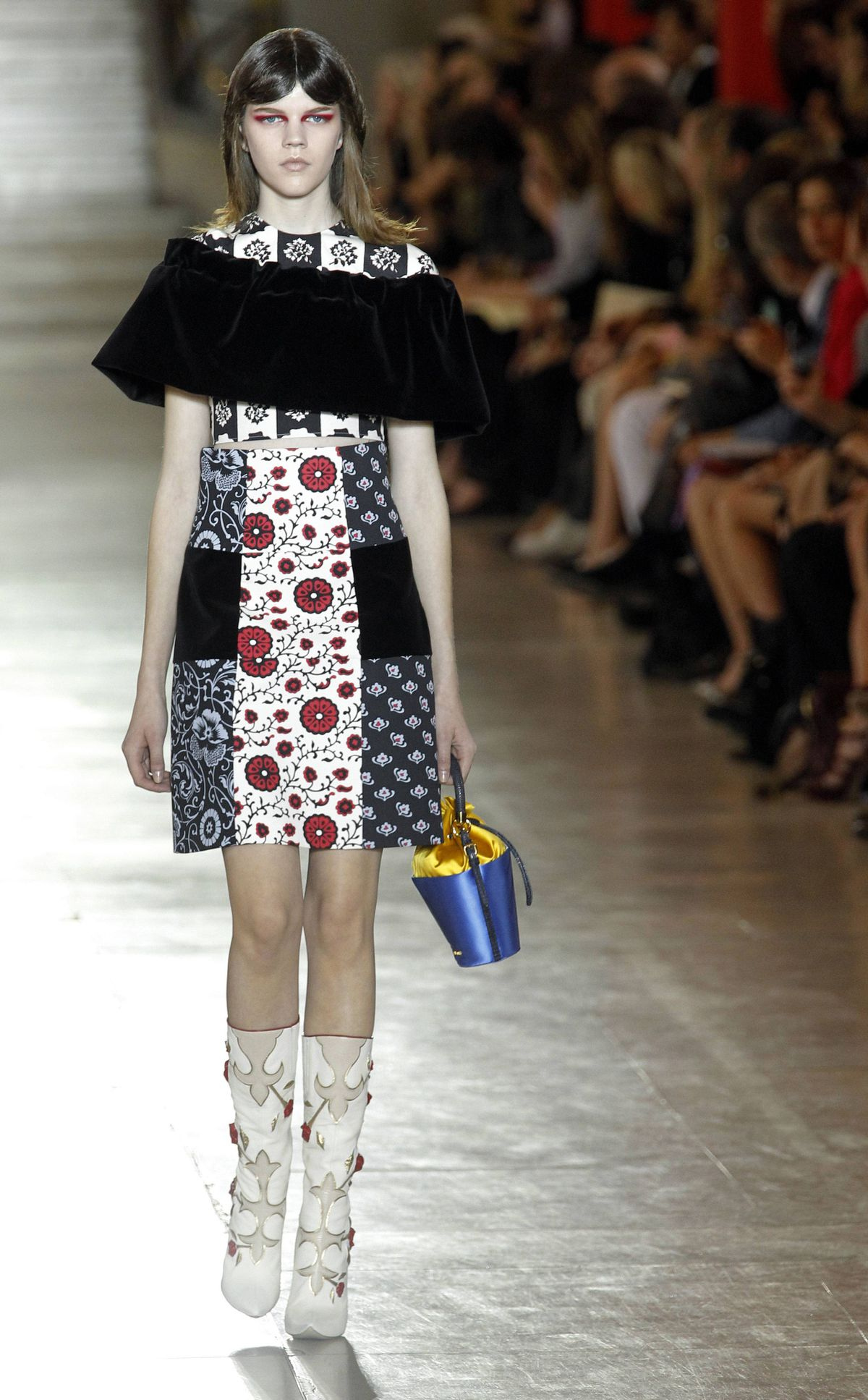 But following a grouping of lace shift dresses (can spring possibly be any lacier?), came the Miu Miu gal as we know and love her: a patchwork of eccentric upholstery prints. Somewhere, a castoff family of sofas and drapes is begging for credit.