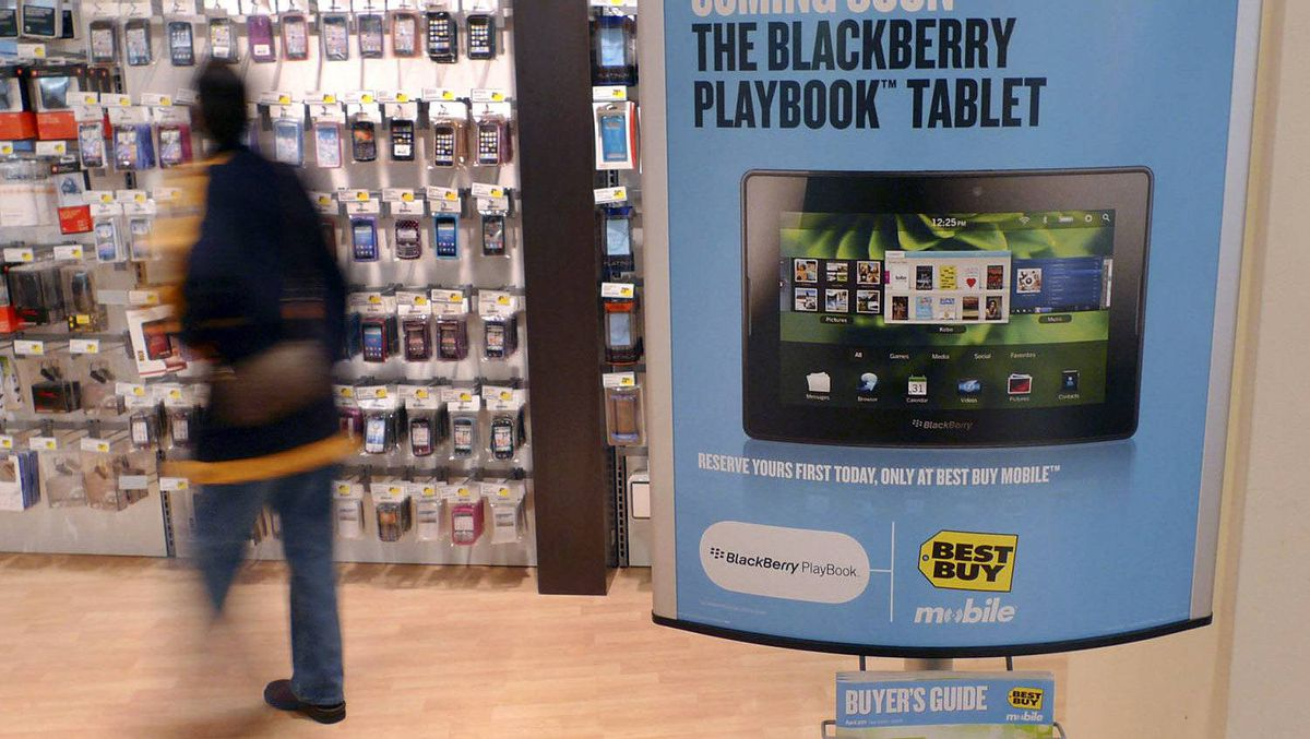 A sign advertising a Research In Motion's PlayBook tablet is seen in FairOaks Mall,Virginia April 19, 2011.