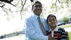 Yousef Syed and his son Aayez, 8, are photographed near their mosque in Toronto, Ont. July /2011