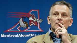 Larry Smith, president and CEO of the Montreal Alouettes, ponders a question after announcing that he will be leaving the CFL club as of Dec. 31, 2010 during a news conference Monday, November 8, 2010 in Montreal.