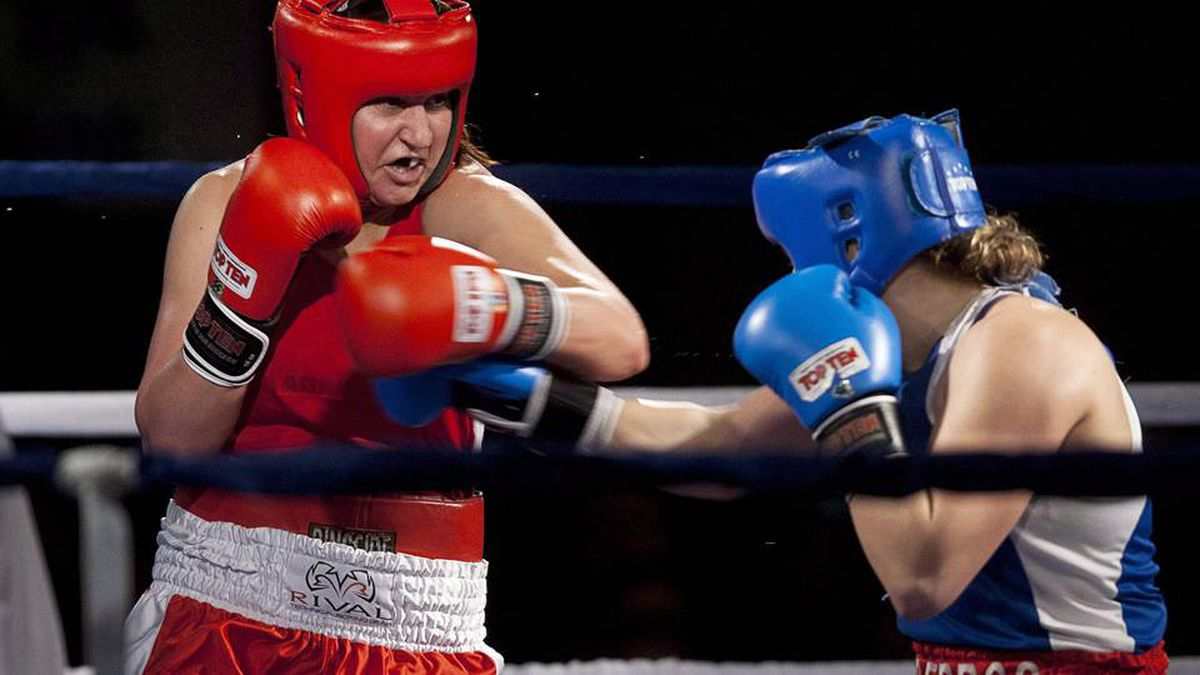 Ontario's Mary Spencer, left, battles Quebec's Ariane Fortin to win the 75kg event at the Canadian boxing championships in Sydney, N.S. on Friday, Jan. 13, 2012.