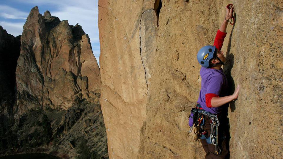 Erik Gerdes, 30, hooks his rope into the bolt above his head at Cinammon Slab wall at Smith Rock State Park near Redmond, Ore., Friday, March 16, 2007.