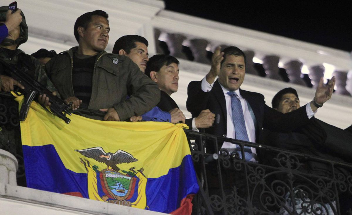 Ecuador's President Rafael Correa speaks from the balcony of the Carondolet Palace in Quito as hundreds of supporters gathered to greet him after he was rescued from rebel police. Guillermo Granja/Reuters