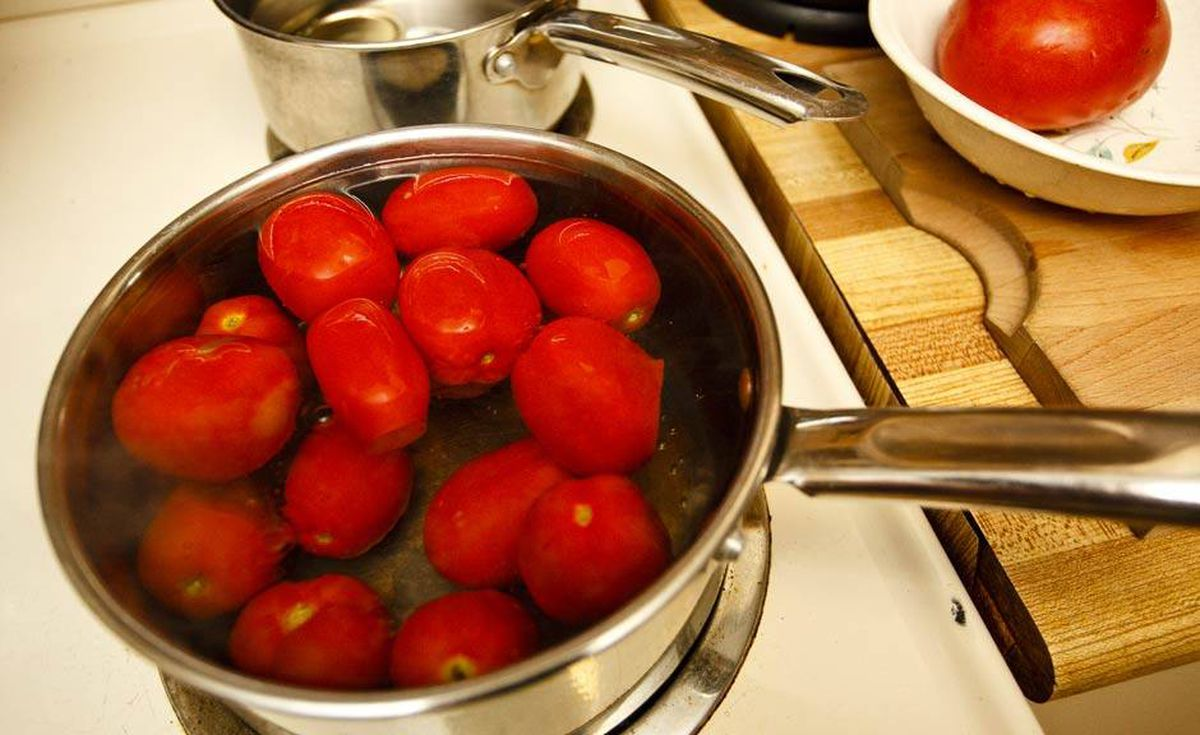 She then blanches the tomatoes for 45 seconds to make them easier to peel.