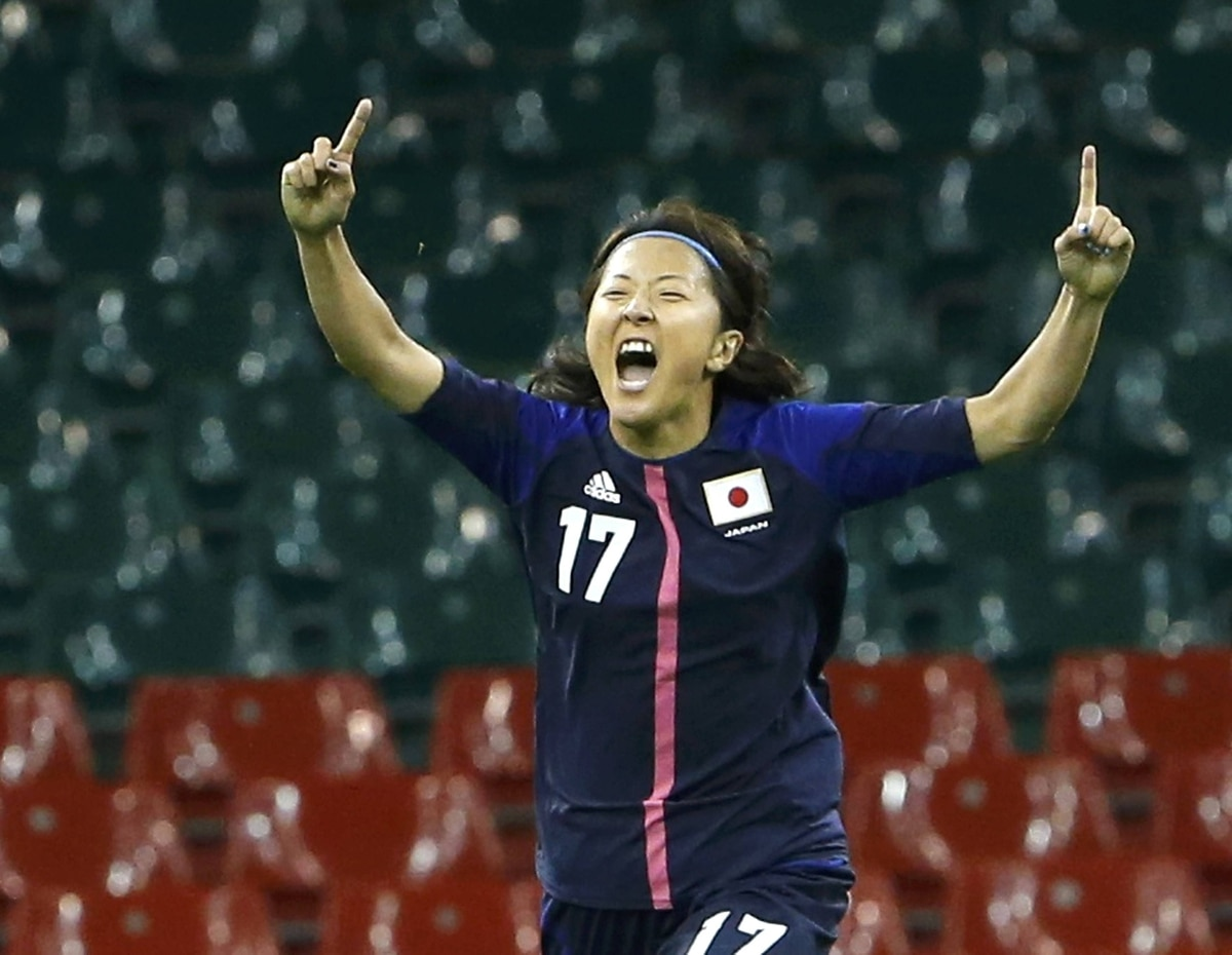 Japan's Yuki Ogimi celebrates scoring on Brazil in their women's quarter final soccer match at Millennium Stadium in Cardiff. Japan defeated Brazil 2-0 in the quarter-final.