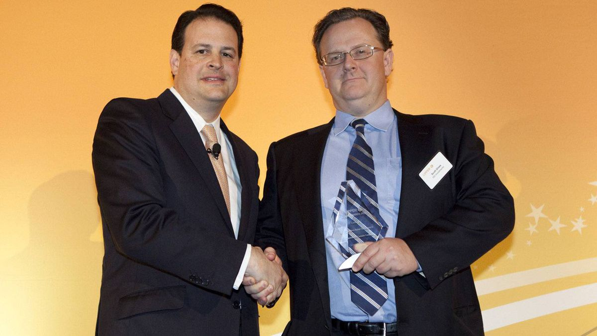 Jim Weber of Thomson Reuters, left, with Scott Gives of SEI Investments, who accepts the award for the SEI Short Term Bond Fund.