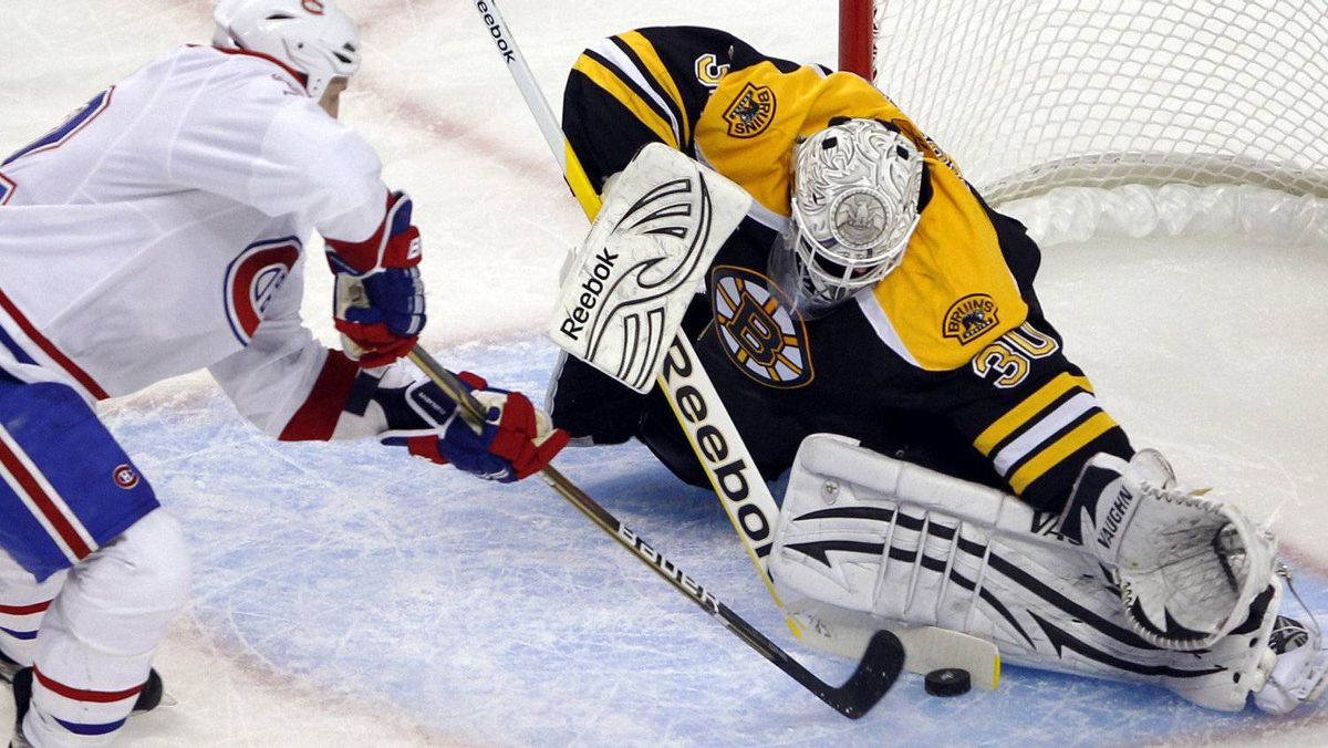 Boston Bruins goaltender Tim Thomas (R) makes a save against Montreal Canadiens left wing Travis Moen during the second period in Game 2 of their NHL Eastern Conference quarter-final hockey game in Boston, Massachusetts April 16, 2011. REUTERS/Brian Snyder