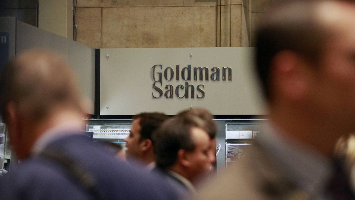 Traders work on the floor of the New York Stock Exchange near the Goldman Sachs stall July 16, 2010.