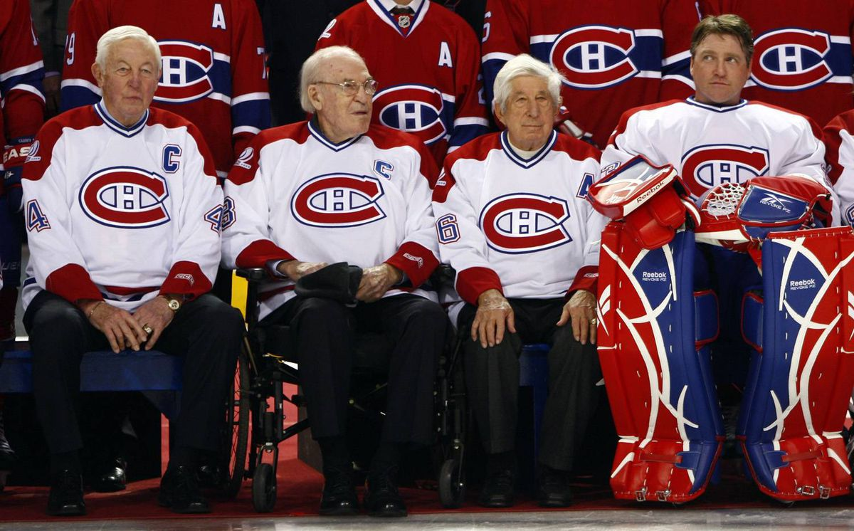 Montreal Canadiens legends (L-R) Jean Beliveau, Emile Bouchard, Elmer Lach and Patrick Roy sit together during a ceremony to celebrate the Canadiens 100th anniversary in Montreal, December 4, 2009.