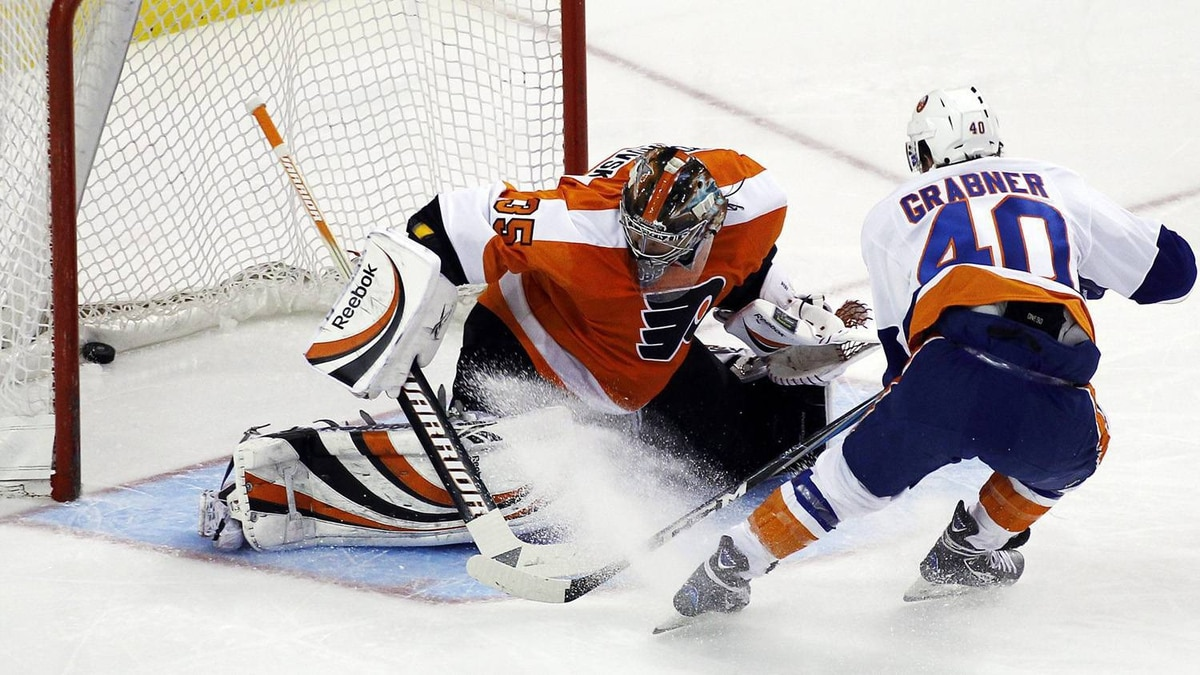 New York Islanders' Michael Grabner, right, scores past Philadelphia Flyers goalie Sergei Bobrovsky in the first period of an NHL hockey game, Saturday, April 9, 2011, in Philadelphia. The Flyers won 7-4. (AP Photo/Tom Mihalek)