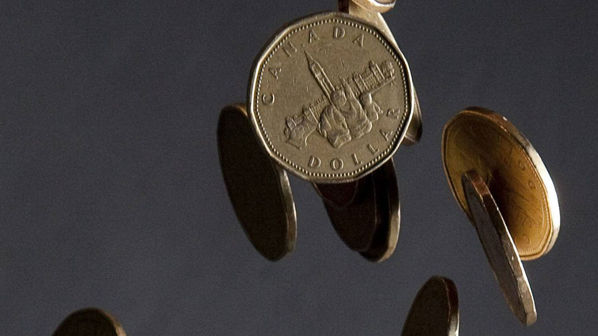 Canadian dollars fall through the air in a photo illustration in Vancouver, B.C. Thursday, Sept. 22, 2011.
