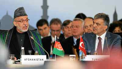 Afghan President Hamid Karzai and his Turkish counterpart, Abdullah Gul, speak in Istanbul on Wednesday at a conference to discuss=approaches to improved security and economic development.