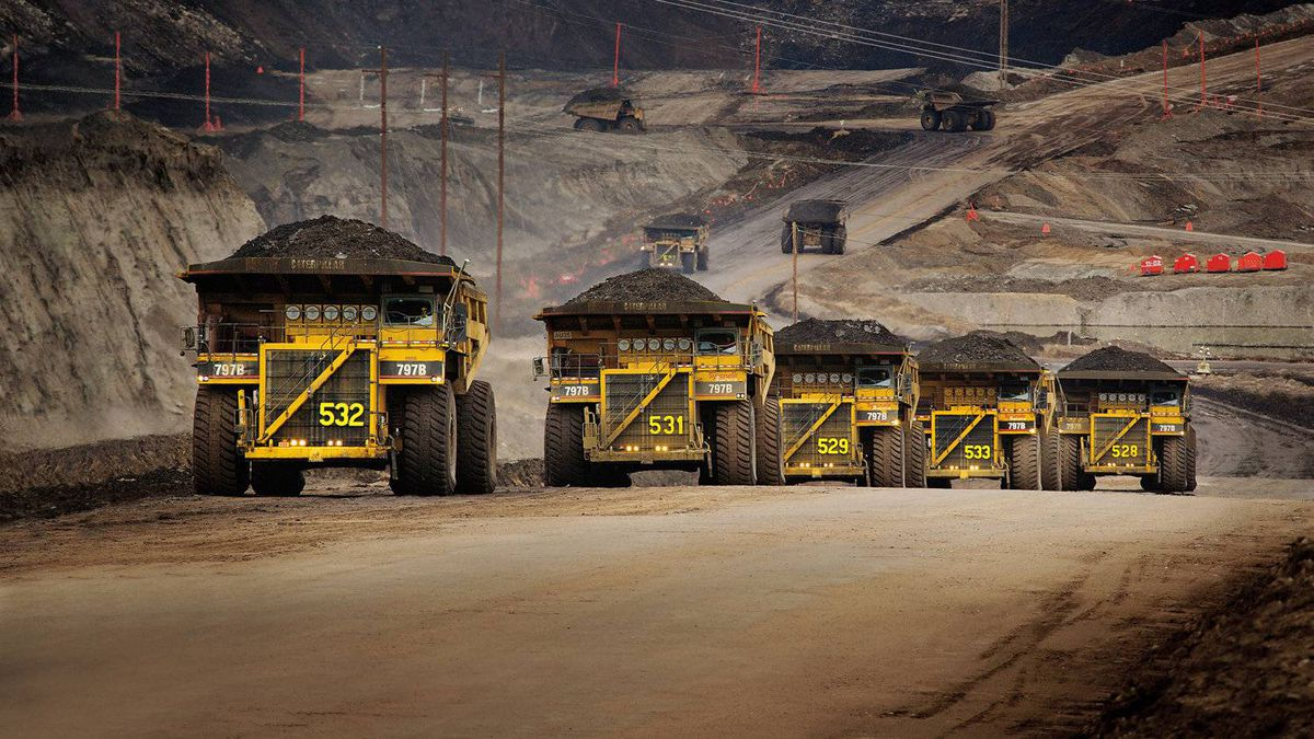 Caterpillar trucks working in the oil sands in Alberta. In response to proposed European Union rules, a new Alberta government-sponsored study says oil sands crude is not significantly higher in greenhouse gas footprint than other crudes used in Europe.