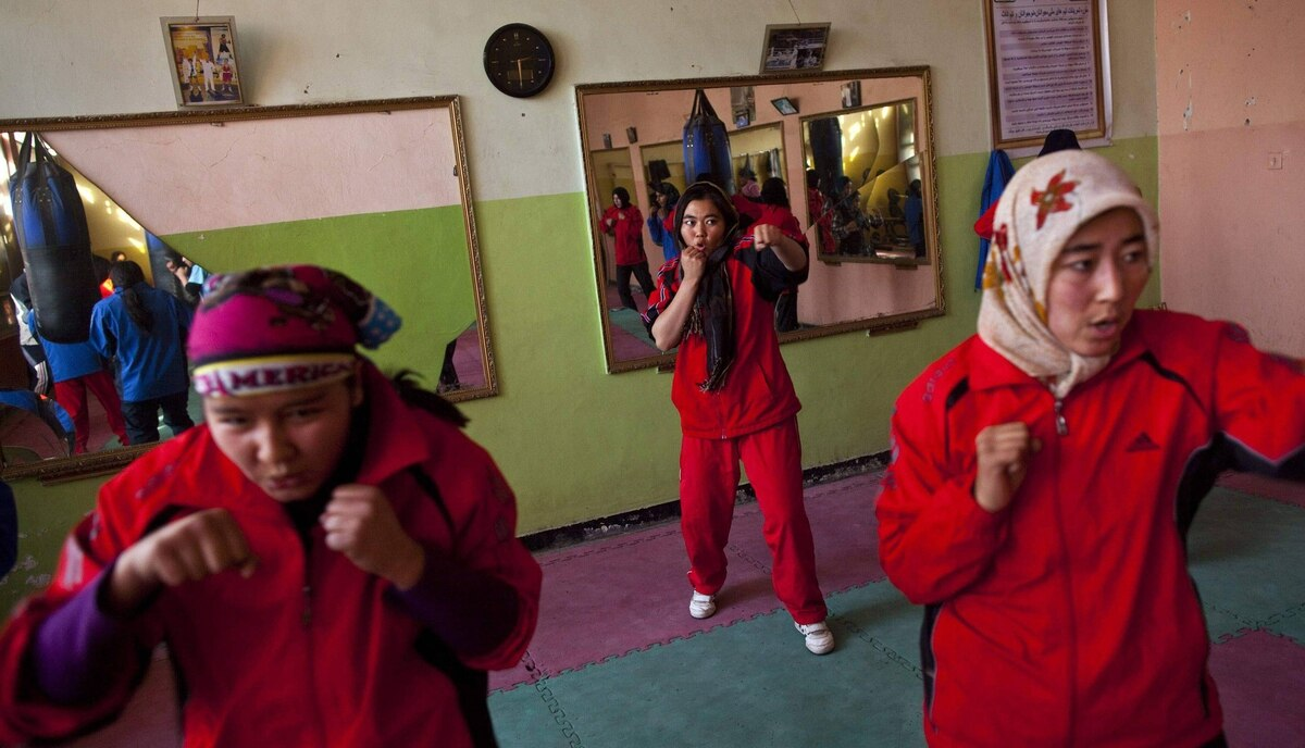 Afghan women practise inside a boxing club in Kabul December 26, 2011.