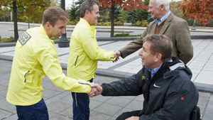 General-General David Johnston and Rick Hansen shake hands with relay participants at Rideau Hall on Oct. 26, 2011 to mark the 25th anniversary of the Man in Motion tour.
