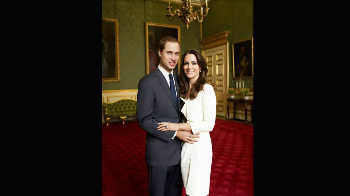 Britain's Prince William and Kate Middleton pose in one of two official engagement portraits, taken by photographer Mario Testino in the Council Chamber in the State Apartment at St James's Palace in London on November 25, 2010.