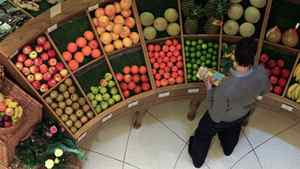 A customer looks at fruit in a store in central London April 12, 2011.