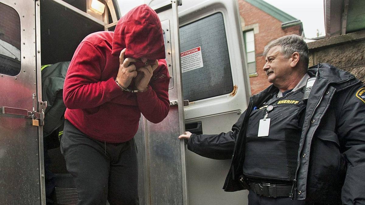 Sub-Lieutenant Jeffrey Delisle arrives at Provincial Court in Halifax on Feb. 28, 2011.