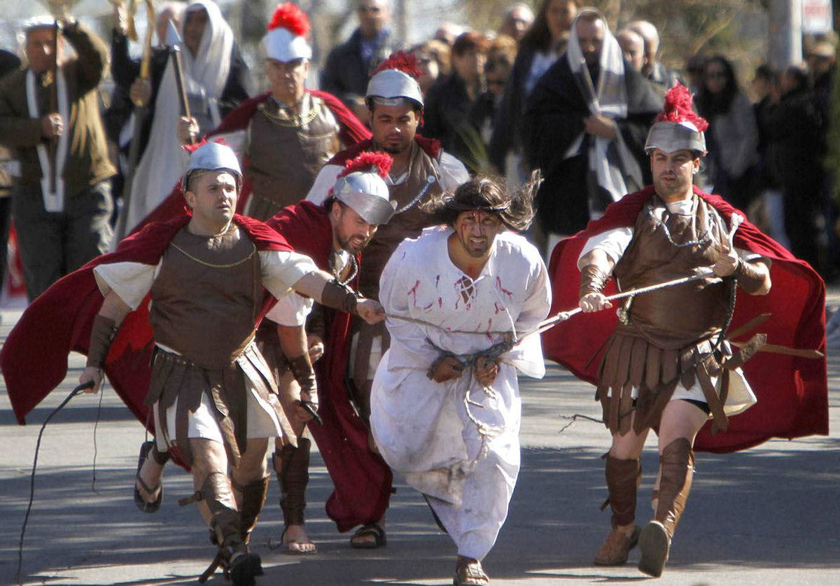 Members of St. Francis of Assisi Church re-enact Jesus Christ's path to crucifixion and then redemption on Good Friday in Toronto.
