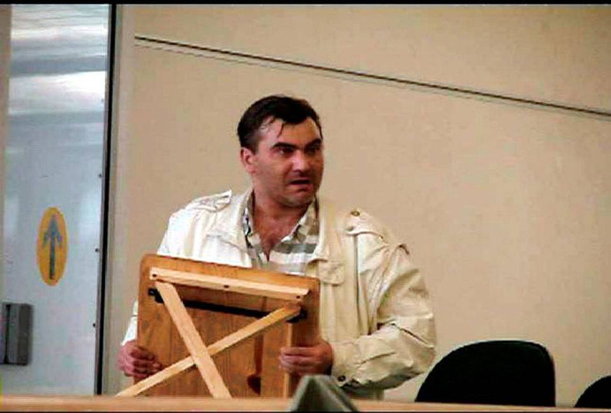 FILE -- Robert Dziekanski holds a small table at the Vancouver Airport in this image from video.The final hours of Dziekanski's life, from when he boarded a plane in Poland to when he lay writhing on the floor of Vancouver's airport after being stunned by an RCMP Taser, will be recounted by dozens of witnesses at a public inquiry beginning Monday. THE CANADIAN PRESS/HO-Paul Pritchard