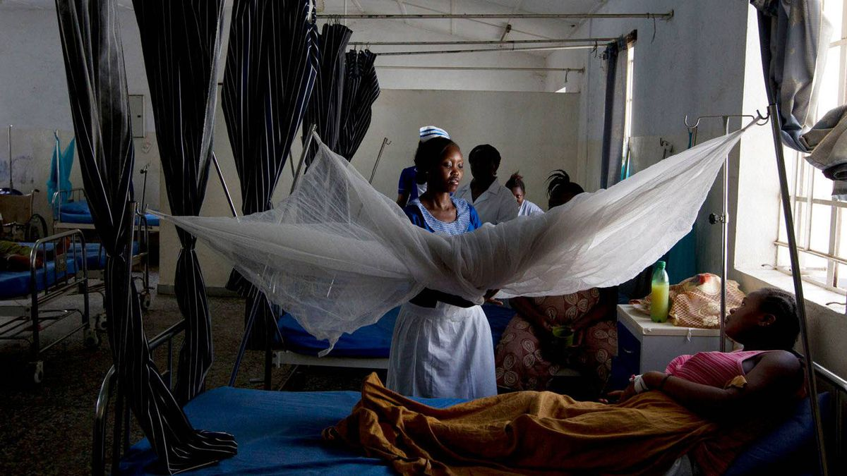 A nurse checks on a patient in a ward of pregnant women who were having difficulty before giving birth.