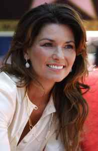 Canadian country singer Shania Twain poses after unveiling her star on the Walk of Fame in Hollywood, California June 2, 2011.
