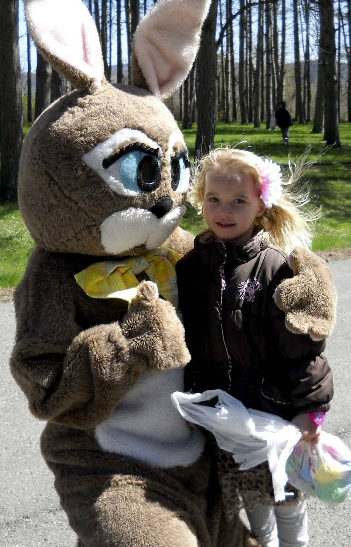 Don't look so down, kid at an Easter egg hunt in Pennsylvania on Saturday: You could be getting hugged by this next furry Easter celebrant.