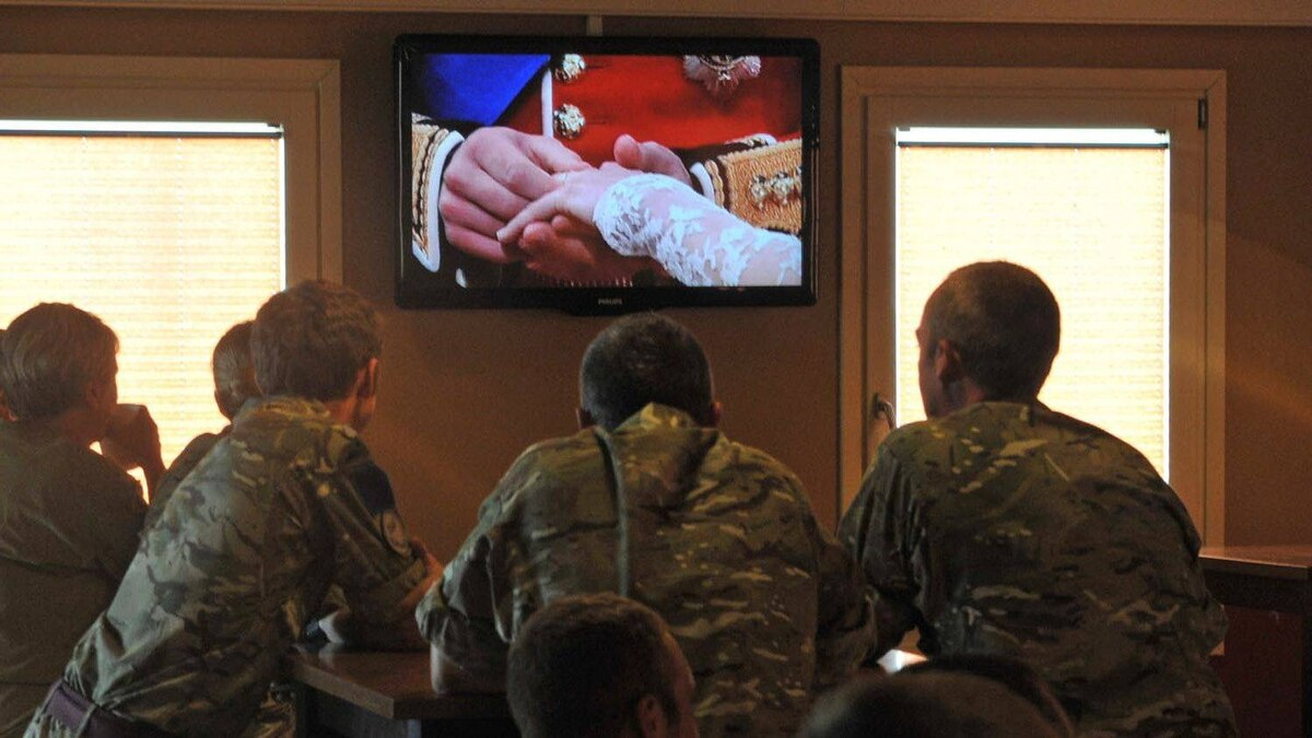 British soldiers in Afghanistan watch the live broadcast of the Royal wedding at Camp Bastion in Helmand province, on April 29, 2011.
