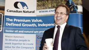 Steve Laut, president of Canadian Natural Resources, smiles before addressing the company's annual meeting in Calgary, Thursday, May 5, 2011.