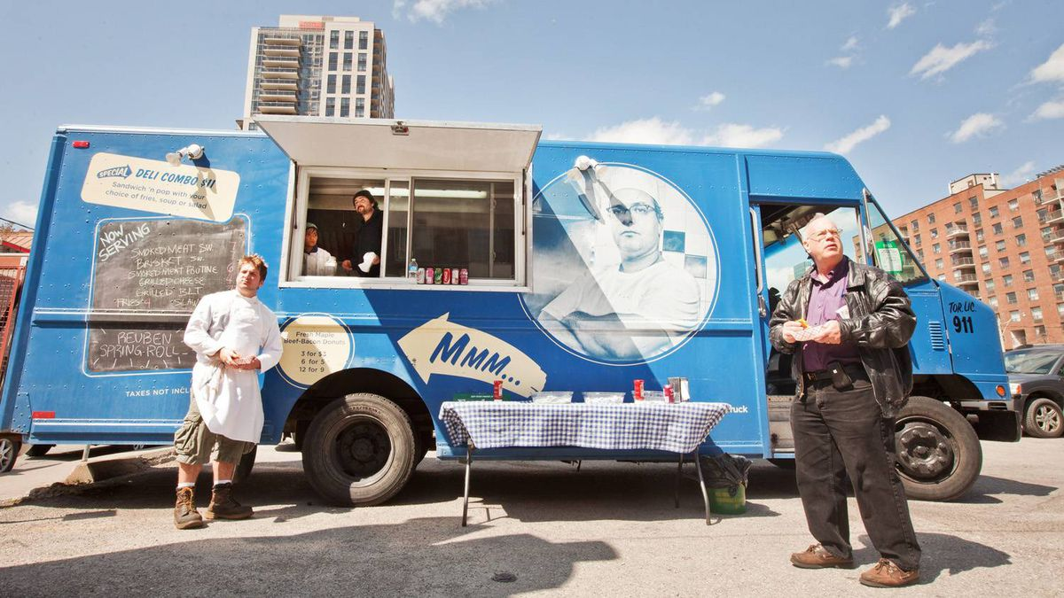 Line cook Nick Lachcik and customer Allan Eisen at the Thundering Thelma food truck in downtown Toronto. The mobile business is piloting the PayPal Here service, giving customers a chance to forgo physical cash and conventional wallets.