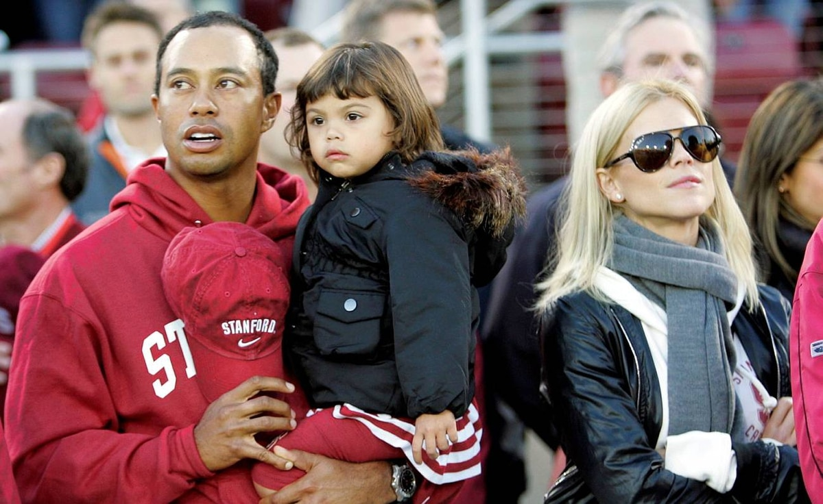 Tiger Woods with his daughter Sam and wife Elin are seen before the start of a NCAA college football game between Stanford and California in Stanford, Calif. Nov. 21.