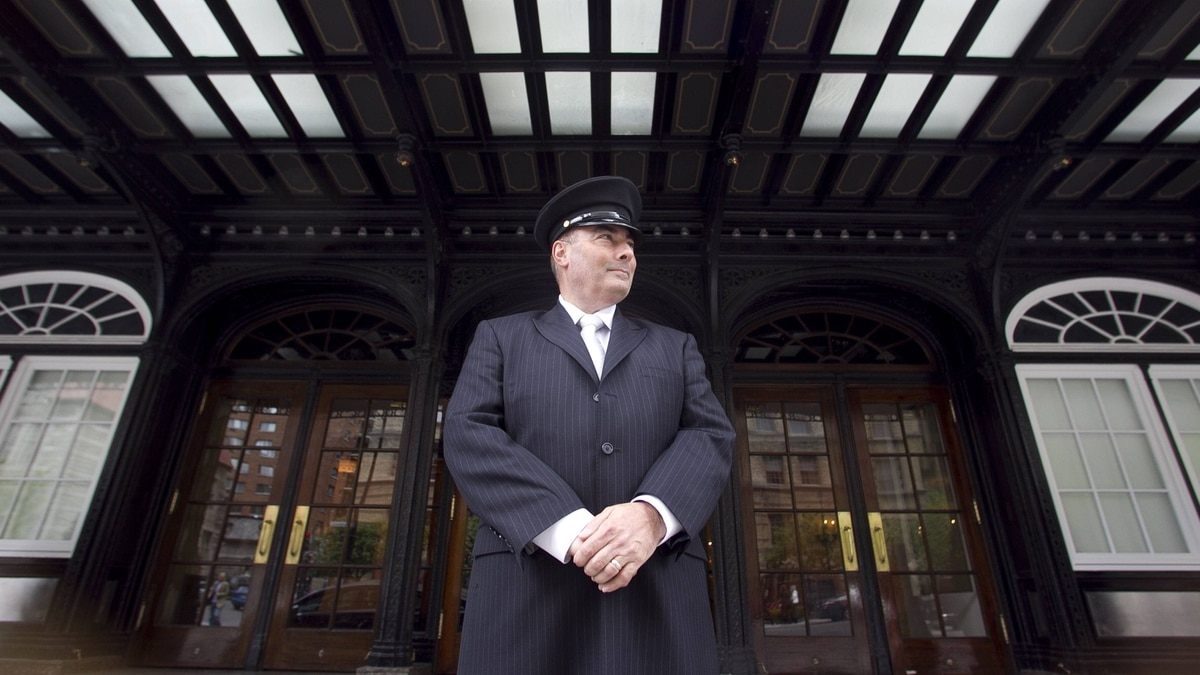 Porter Denis Lopes stands guard outside the Ritz on Sherbrooke Street.