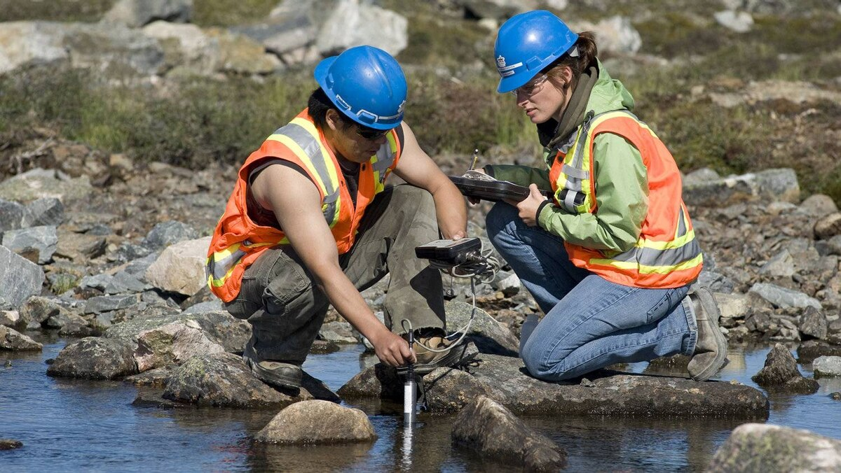Employees taking water samples as part of Agnico-Eagle's environmental monitoring practices.
