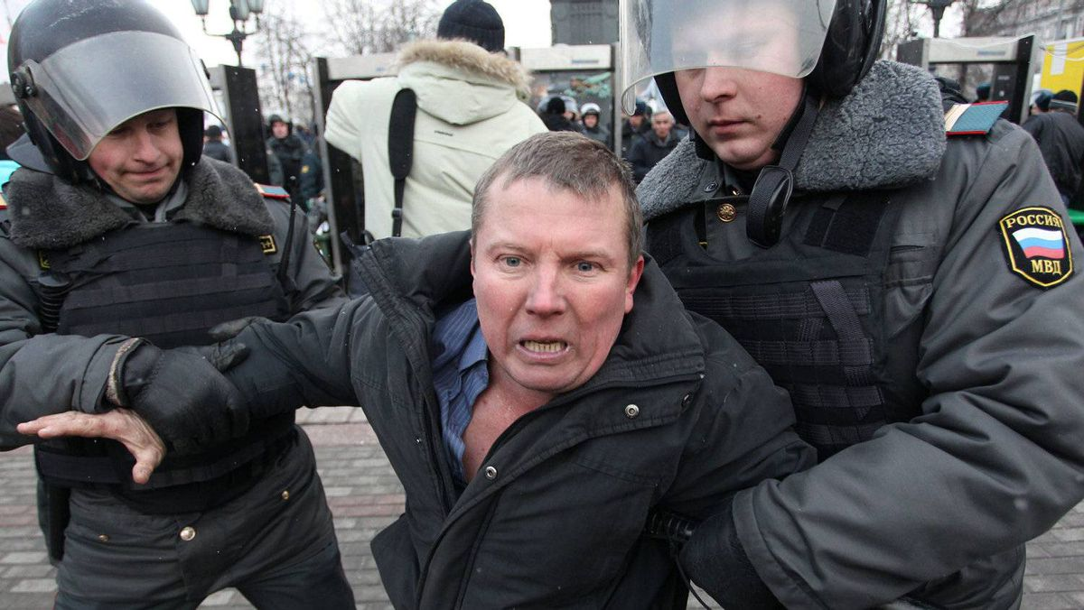 Russian police officers detain protester after a rally in Moscow, Russia, Monday, March 5, 2012.