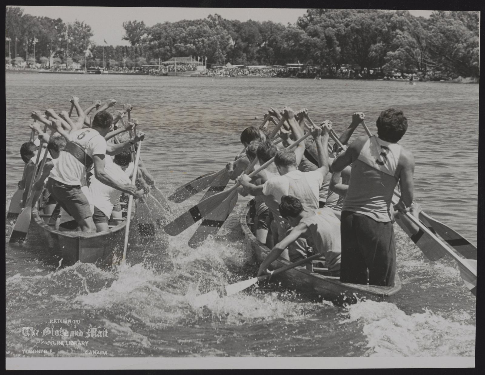 CANOES Dave Findlay (6) has his Carleton Place entry leading Balmy Beach crew in junior war canoe race in the Dominion Day regatta at Long Pond, [July 1, 1969].