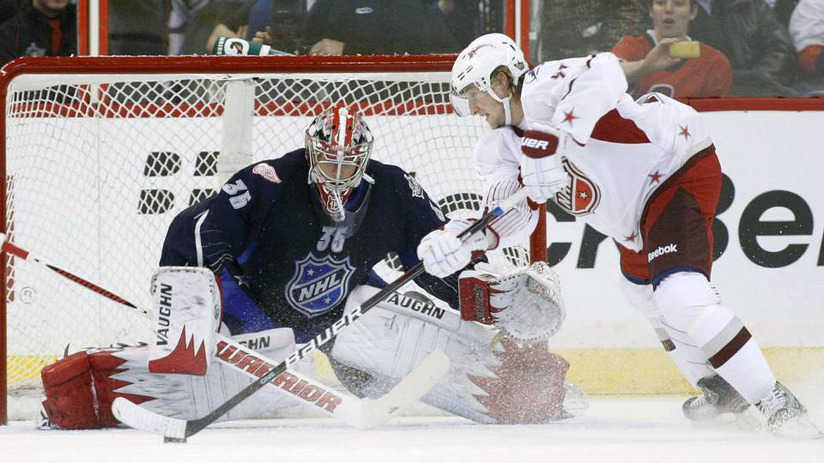 Detroit Red Wings goalie Jimmy Howard (L) of Team Chara stops Tampa Bay Lightning Steven Stamkos of Team Alfredsson on a penalty shot during the NHL all-star hockey game in Ottawa.