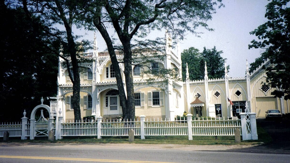 Patti Baldwin McCann photo: Wedding Cake House - built by George W. Bourne in 1825 situated in Kennebunk, Maine. He built this most usual home for his new bride!